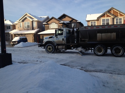 """Snow trucks """"blade"""" the streets in the neighbourhoods, clearing snow, and spreading sand and gravel, to make it easier to get around"""