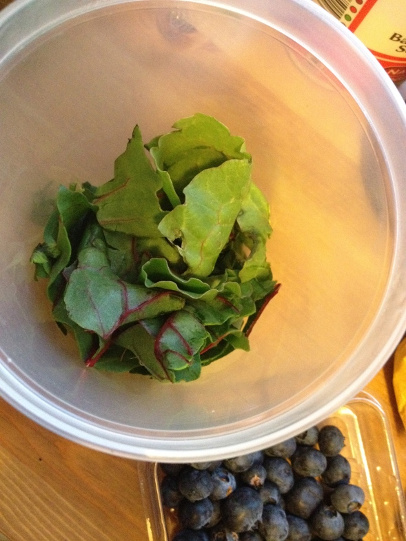 Add 1 cup of greens to a container: kale, chard, spinach, parsley, mint...