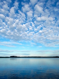 Amazing sky and water at dusk, on Astotin Lake