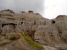 Hoodoos have rocks at the top of columns of mud.
