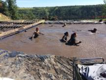 There were several muddy swims at the Mud Hero Run in Red Deer
