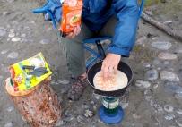 Making a quesadilla in camp