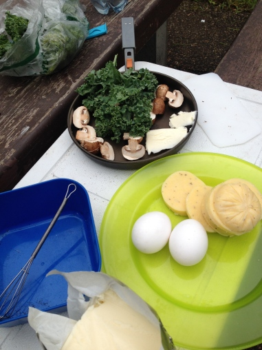 Polenta (cooked cornmeal) with eggs and veggies