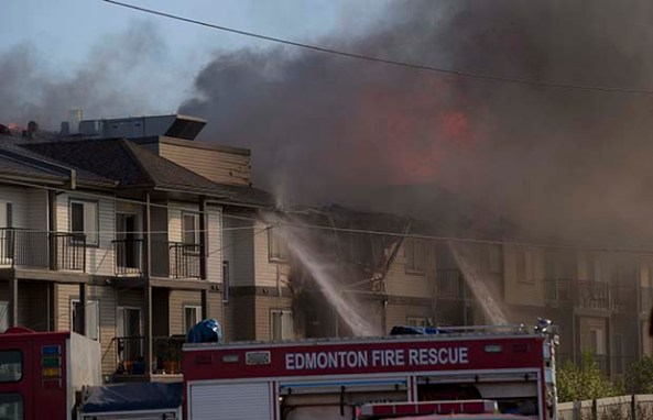 Residents of fire-ravaged Edmonton condo complex forced to spend night at nearby rec centre