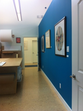 Several of the gallery walls have warm, rich colours, chosen by his wife. Their six children all live nearby.