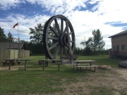 Giant wagon wheel & pick: Fort Assiniboine