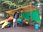 An excellent tarp system and cooking setup!
